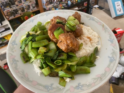 Hoisin-Glazed Pork Meatballs with Stir-fried Snap Peas and Bok Choy on Coconut Rice